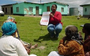 A ciet field worker shares evidence from a study with a group of women in South Africa